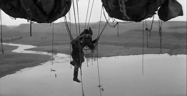 A man challenges the rigid order of things in a Medieval world in the prologue to Andrei Tarkovsky's Andrei Rublev (1966)