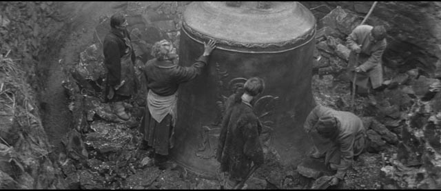 The bell is revealed as the clay mold is chipped away in Andrei Tarkovsky's Andrei Rublev (1966)
