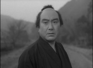 Genpachi (Chiezô Kataoka), a servant who tries to protect his weak master in Tomu Uchida's Bloody Spear at Mount Fuji (1955)