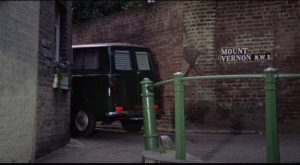 Freddie (Terence Stamp) stalks his prey in an unmarked van in William Wyler's The Collector (1965)
