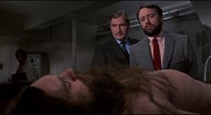 Drs. Maitland (Nigel Davenport) and Berger (Robert Vaughan) plan to wake John (Terence Stamp) from a life-long coma in Alan Cooke's The Mind of Mr. Soames (1970)