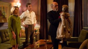A helpful priest assists a couple plagued by a demon in John R. Leonetti's Annabelle (2014)