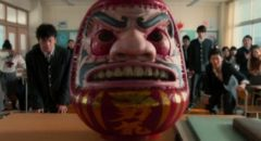 The deadly Daruma doll in the bloody opening scene of Takashi Miike's As the Gods Will (2014)