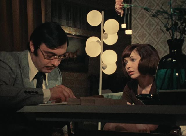 Unhappily married Monika (Renate Roland) asks husband Harald (Kurt Raab) for a divorce in Rainer Werner Fassbinder's Eight Hours Don't Make a Day (1972-73)