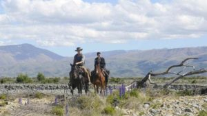 A laconic gunman and a lovesick Scottish boy discover darkness in John Maclean's Slow West (2015)