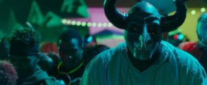 The inaugural event starts as a big street party in Gerard McMurray's prequel The First Purge (2018)