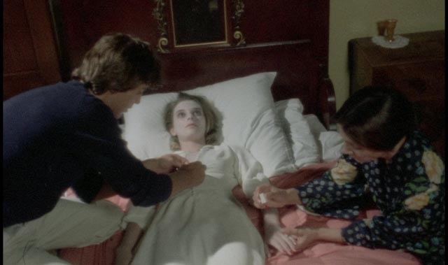 "Housekeeper Iris (Franka Stoppi) helps Frank (Kieran Canter) to make his dead fiancee ""comfortable"" in Joe D'Amato's Beyond the Darkness (1979)"