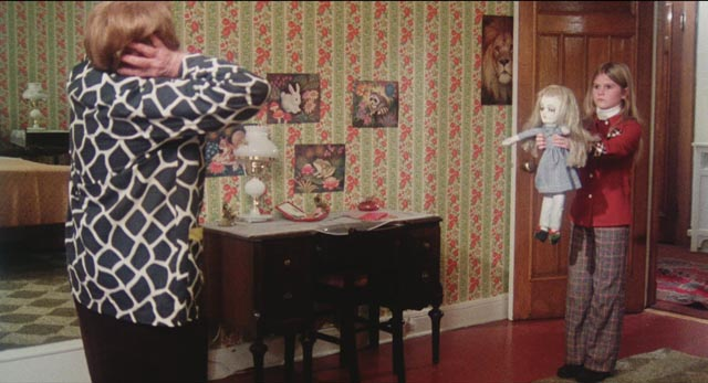 Cathy (Randi Allen) and her doll drive the housekeeper (Dorothy Davis) to her death in Eddy Matalon's Cathy's Curse (1976)