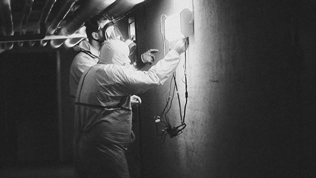 Cleaning crews work continuously to control the alien contamination in Henrik Möller's Feed the Light (2014)