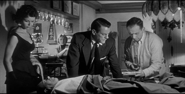 Becky (Dana Wynter), Miles (Kevin McCarthy) and Jack (King Donovan) examine the strange body in Don Siegel's Invasion of the Body Snatchers (1956)