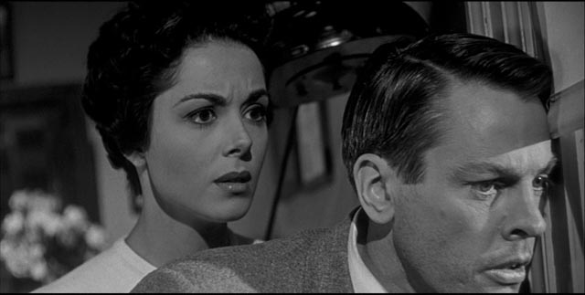 Becky (Dana Wynter) and Miles (Kevin McCarthy) are trapped in Santa Mira, watching the town succumb to the alien takeover in Don Siegel's Invasion of the Body Snatchers (1956)
