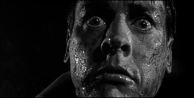Miles (Kevin McCarthy) realizes that Becky (Dana Wynter) has also been taken over in Don Siegel's Invasion of the Body Snatchers ...