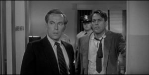 The studio-imposed frame offers competent authorities to reassure the audience that the aliens can be defeated in Don Siegel's Invasion of the Body Snatchers (1956)