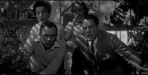 Fear becomes real when pods are discovered in the Belicec's greenhouse in Don Siegel's Invasion of the Body Snatchers (1956)