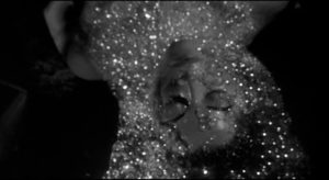 The pod gives birth to a template waiting to be imprinted with a now-emotionless duplicate personality in Don Siegel's Invasion of the Body Snatchers (1956)