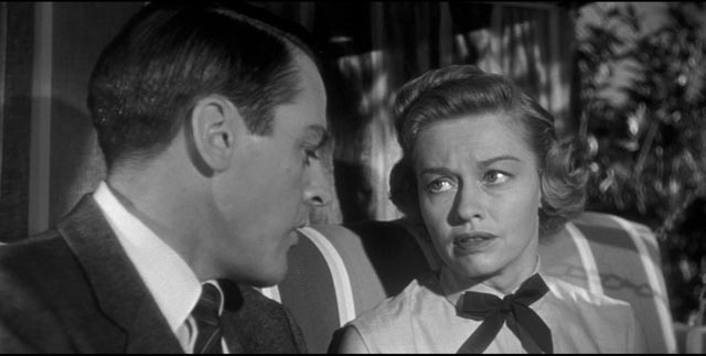 Dr. Miles Bennell (Kevin McCarthy) reassures Wilma (Virginia Christine) that her fears are imaginary in Don Siegel's Invasion of the Body Snatchers (1956)