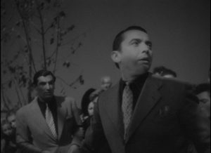 Alfred (Paul Bernard) raises the alarm about the murdered woman in Julien Duvivier's Panique (1946)