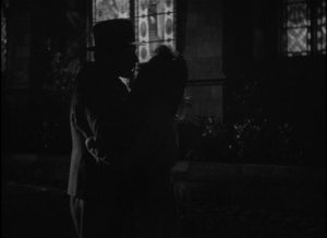 Alice (Viviane Romance) and Alfred (Paul Bernard) reunite after her release from prison in Julien Duvivier's Panique (1946)