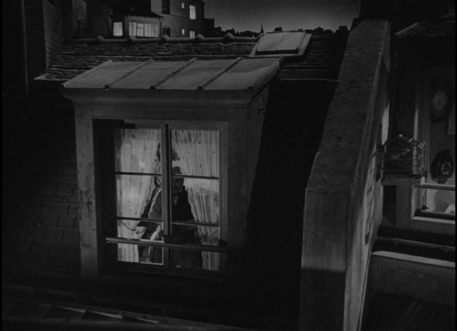 M. Hire Michel Simon) takes a voyeuristic interest in his new neighbour, Alice (Viviane Romance) in Julien Duvivier's Panique (1946)