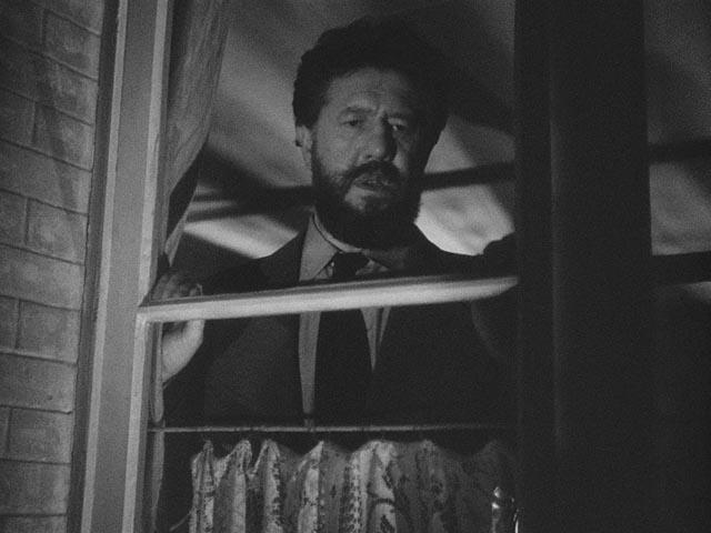 M. Hire Michel Simon) takes a voyeuristic interest in his new neighbour, Alice (Viviane Romance) in Julien Duvivier's Panique (1946)