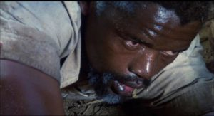 Helpless African leader Julius Limbani (Winston Ntshona) in need of White rescue in Andrew V. McLaglen's The Wild Geese (1978)