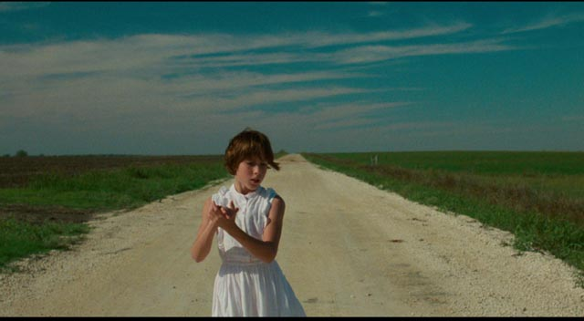 Capucine DeWulf opens David Byrne's True Stories (1986) with a mysterious private little dance on an empty road.
