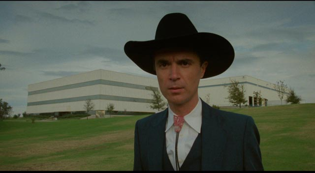 David Byrne, the wide-eyed curious Narrator visits the local electronics factory in David Byrne's True Stories (1986)