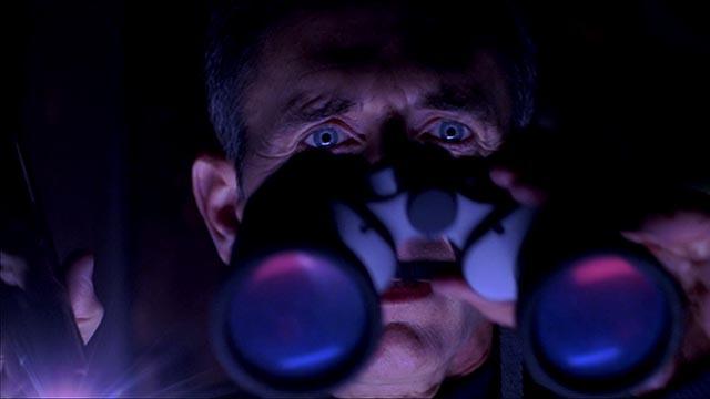 Preston Rogers (Matt McCoy) watches helplessly as a monster stalks the women next door in Ryan Schifrin's Abominable (2005)