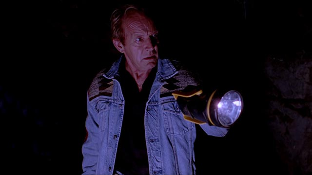 Over-confident hunter Ziegler (Lance Henriksen) wanders off to investigate noises in the night in Ryan Schifrin's Abominable (2005)