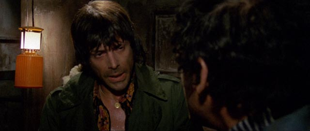 Giullio (Tomas Milian) loses patience with his partners in the kidnapping in Umberto Lenzi's Almost Human (1974)