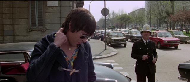 Psychotic Giullio Sacchi (Tomas Milian) prepares to kill a traffic cop in Umberto Lenzi's Almost Human (1974)