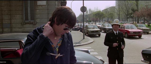 Psychotic Giullio Sacchi (Tomas Milian) prepares to kill a traffic cop in Umberto Lenzi's Almost Human (1974)