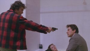 Leo (John Lydon) provokes escalating conflict between O'Connor (Harvey Keitel) and his partner Bob Carvo (Leonard Mann) in Roberto Faenza's Copkiller (aka Corrupt, 1983)