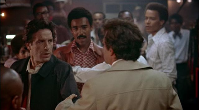 Nicky (John Cassavetes) stirs up conflict with the Black patrons of a bar in Elaine May's Mikey and Nicky (1976)