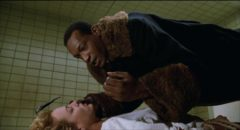Tony Todd's killer ghost schemes to destroy Helen (Virginia Madsen)'s complacent life so she'll have to join him in Bernard Rose's Clive Barker adaptation Candyman (1992)