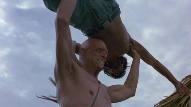 Michael Berryman takes care of the opposition in Ruggero Deodato's Cut and Run (1985)