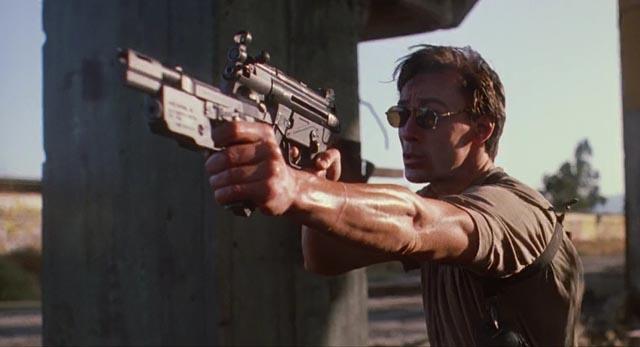Two-fisted gun action: Olivier Gruner in Albert Pyun's Nemesis (1992)
