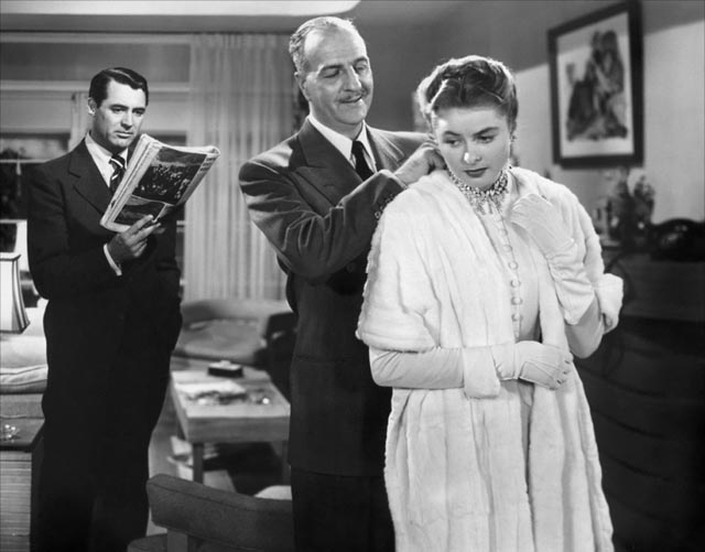 Devlin's boss (Louis Calhern) grooms Alicia for her role as femme fatale in Alfred Hitchcock's Notorious (1946)