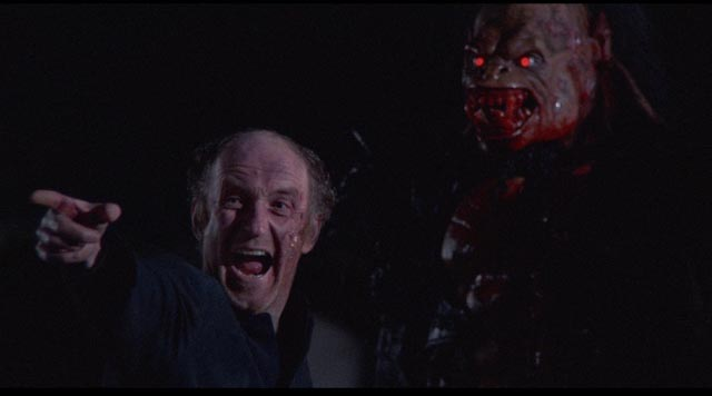 The Verger (Declan O'Brien) becomes a fanatical acolyte of the monster in George Pavlou's Clive Barker adaptation Rawhead Rex (1986)