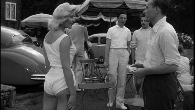 Molly Stevens (Magda Miller) provokes the members of the tennis club in John Guillermin's Town on Trial (1957)