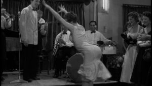 Youth run wild: local kids party at the roadhouse in John Guillermin's Town on Trial (1957)