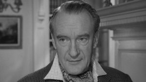 Gordon Zellaby (George Sanders) approaches the strange children with scientific interest and detachment in Wolf Rilla's Village of the Damned (1960)