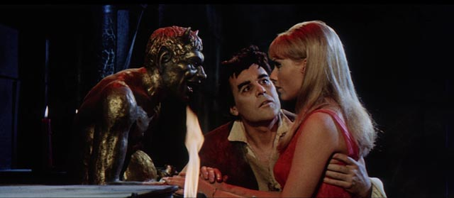 Luther the Berserk (John Lodge) introduces Anastasia (Thordis Brandt) to his master in William O. Brown's The Witchmaker (1969)