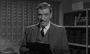 Col. Gore Hepburn (André Morell) uses a class-based deference to authority to rob the bank with ease in Quentin Lawrence's Cash on Demand (1961)