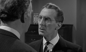 Martinet bank manager Harry Fordyce (Peter Cushing) is no match for Colonel Gore Hepburn (André Morell) in Quentin Lawrences's Cash on Demand (1961)