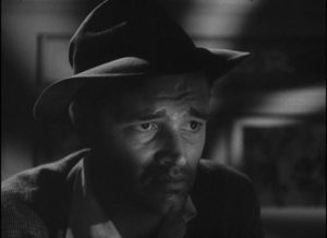 Al Roberts (Tom Neal) contemplates the grim hand he's been handed by Fate in Edgar G. Ulmer's Detour (1946)