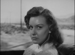 Vera (Ann Savage) knows more about Al (Tom Neal) than he realizes in Edgar G. Ulmer's Detour (1946)