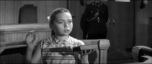 Jean Carter (Janina Faye) takes the stand to testify against the town patriarch in Cyril Frankel's Never Take Sweets from a Stranger (1960)