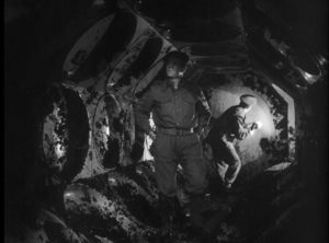 Members of a British Army bomb disposal squad inspect the interior of the alien craft in Nigel Kneale's Quatermass and the Pit (1959)