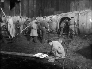 Quatermass and Colonel Breen inspect the ancient crash site in Quatermass and the Pit (1944)